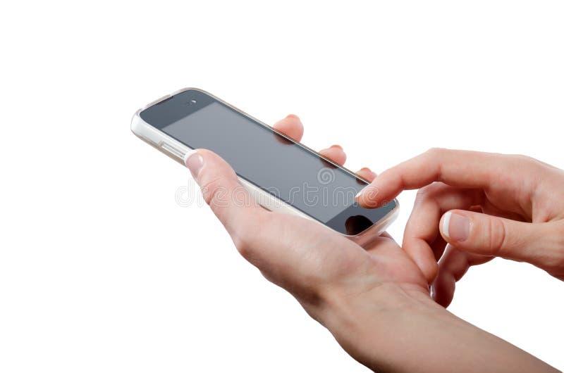 Tela esperta tocante do telefone da mão humana isolada no fundo branco fotos de stock