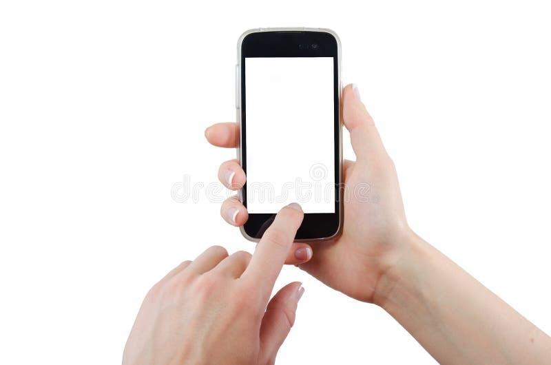 Tela esperta tocante do telefone da mão humana no fundo branco imagens de stock royalty free