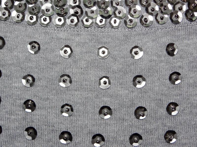 Tela hecha punto con las lentejuelas foto de archivo