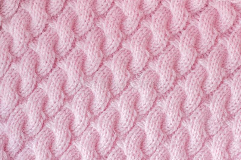 Tela hecha punto hecha de color del rosa del hilado de lanas Modelo fotografía de archivo libre de regalías