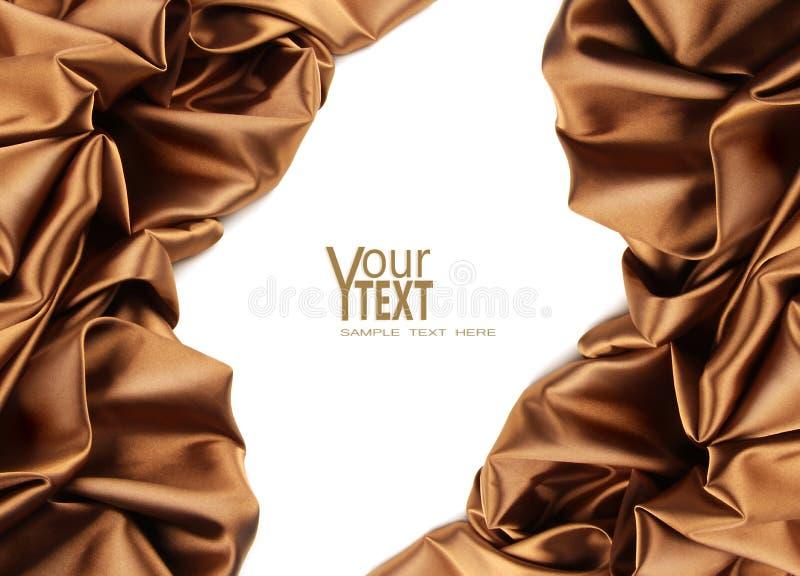Tela marrom dourada rica do cetim no branco fotos de stock royalty free