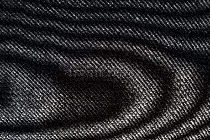 Tela negra con las lentejuelas metálicas foto de archivo libre de regalías