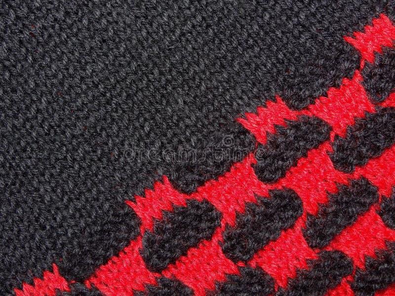 Tela negra y rojo hecha punto fotografía de archivo