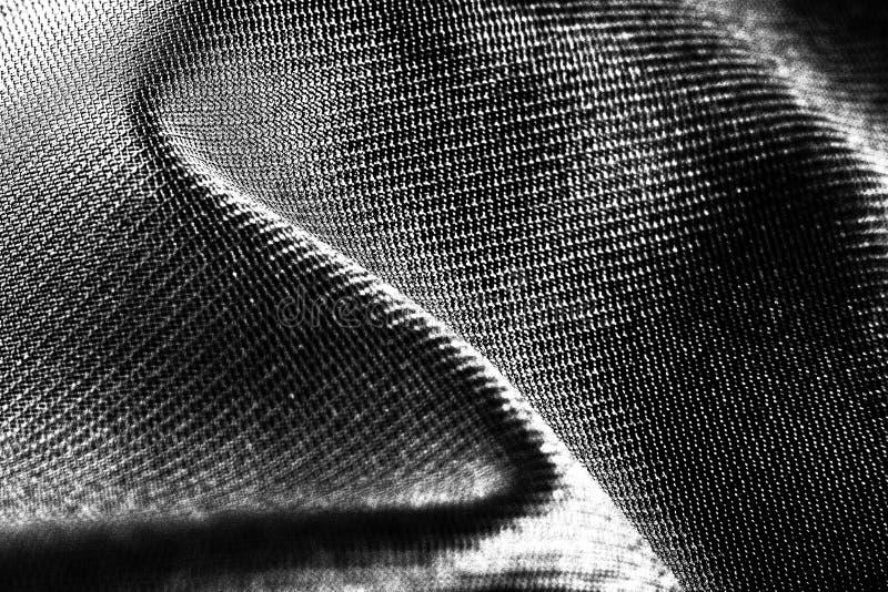 Tela preta do cetim como o projeto da textura do fundo foto de stock
