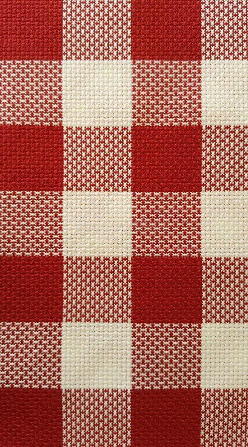 Tela roja y blanca del tablero imagen de archivo