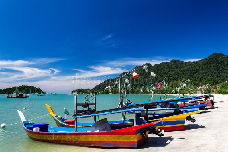Telaga Harbor beach with colourful squid fishing boats on Langkawi island, also known as Pulau Langkawi, State of Kedah, Malaysia. Telaga Harbor beach with stock photos