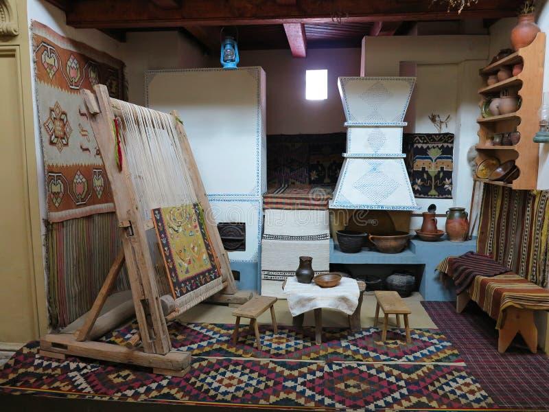 Telaio d'annata di legno antico producendo tappeto immagine stock