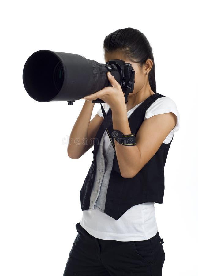 tele kvinna för asiatisk kam arkivfoto