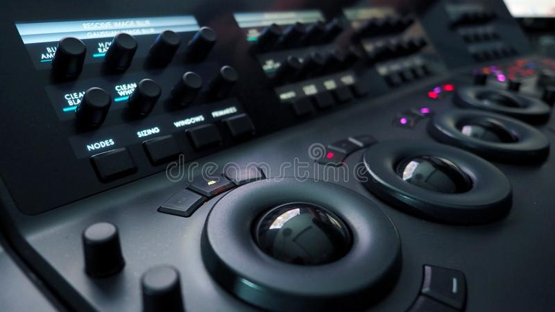 Telecine color grading control machine. Telecine color grading control machine for film director edit or adjust color on digital video movie in post production royalty free stock photos