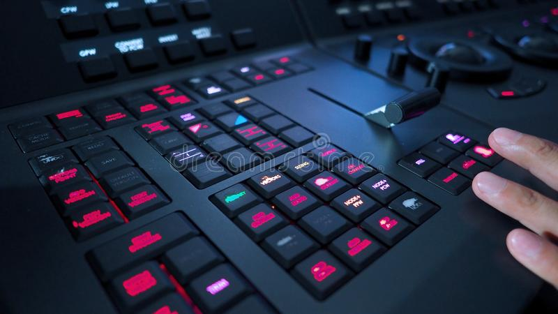 Telecine controller machine and hand editing. Telecine controller machine and man hand editing or adjusting color on digital video movie or film in the post royalty free stock photos