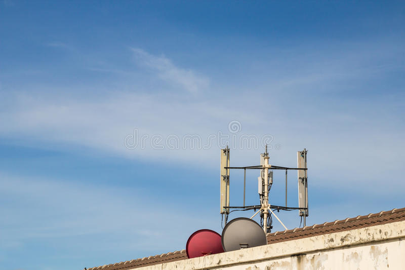 Telecom Pole. GSM transmitters on a roof of sky royalty free stock images