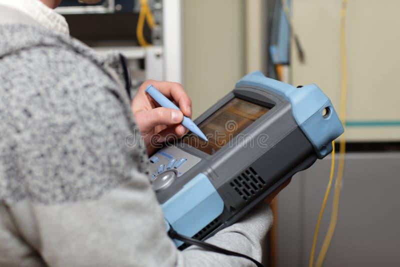 Telecom Technician Adjusting Reflectometer Stock Photo - Image of ...