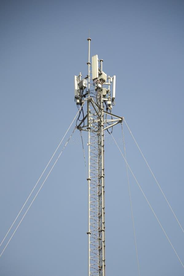 Telecom tower. Pole on blue sky royalty free stock photos