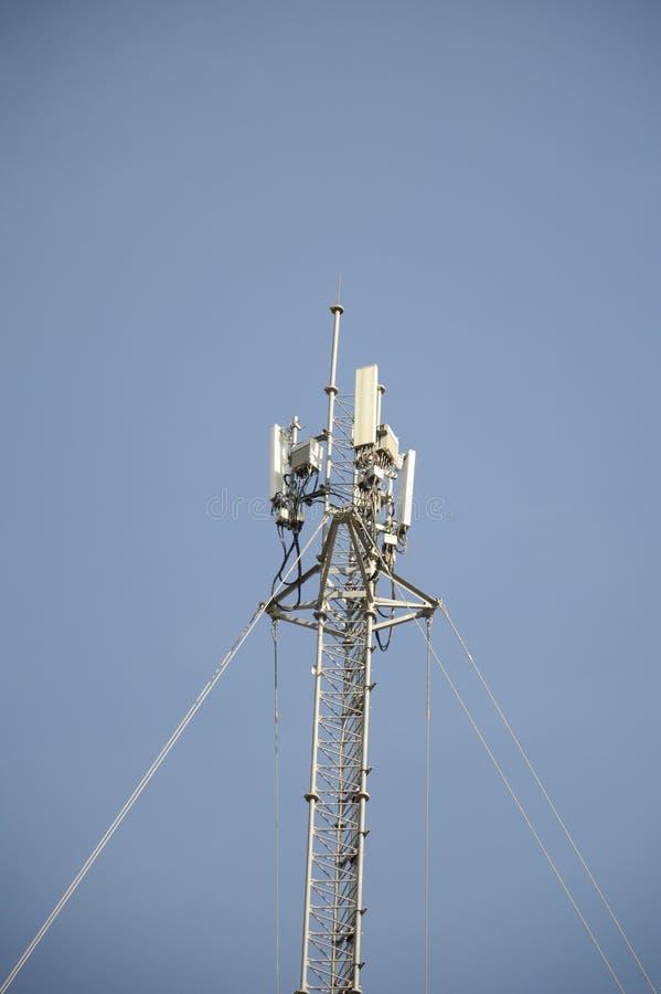 Telecom tower. Pole on blue sky stock photos