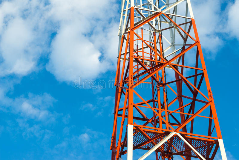 Telecom tower pole. With white cloud royalty free stock photos