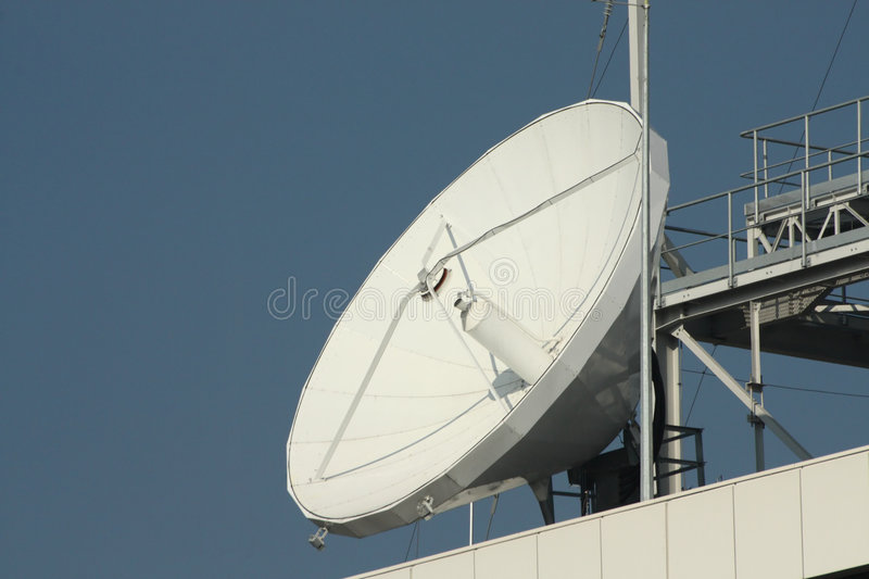 Telecommunication antenna. On the blue sky background stock images