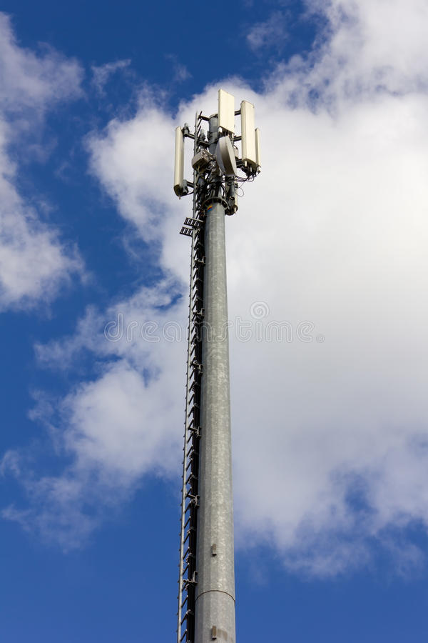Telecommunication Antenna. Against a blue sky stock photography