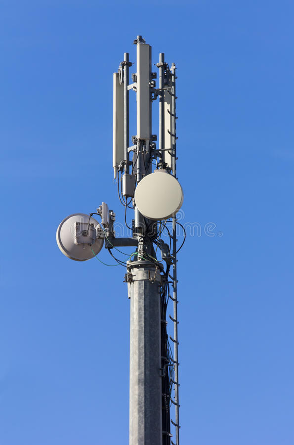Telecommunication Antenna. Against a blue sky stock image