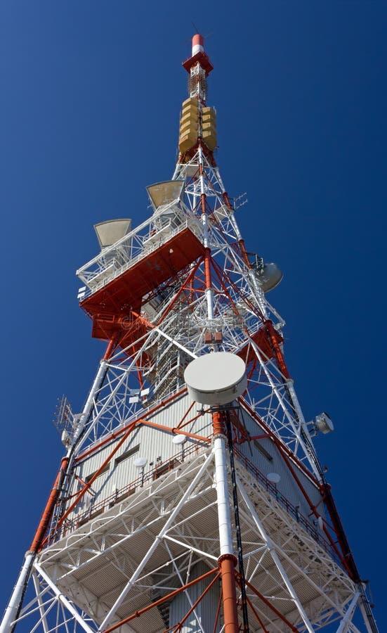 Telecommunication Antenna. Against a blue sky royalty free stock photos