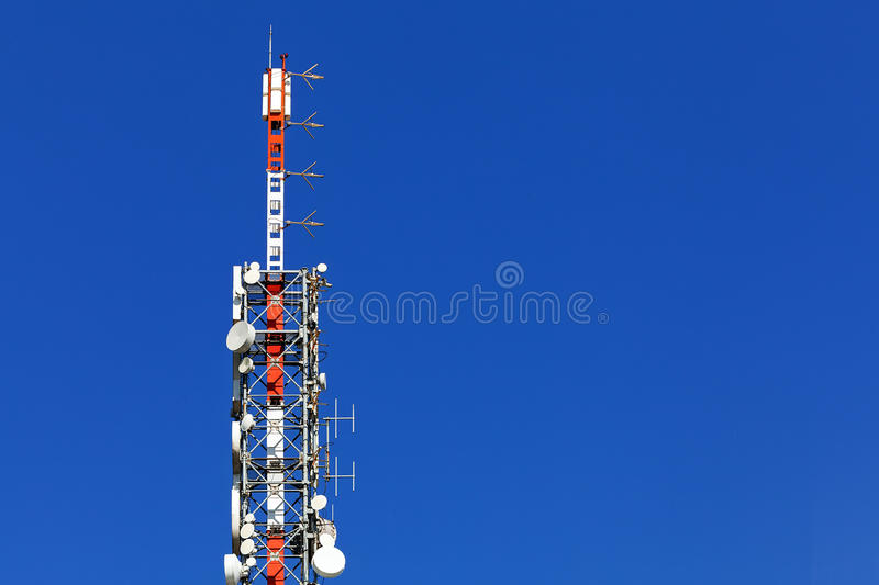 Telecommunication antenna. On top of modern building royalty free stock photos