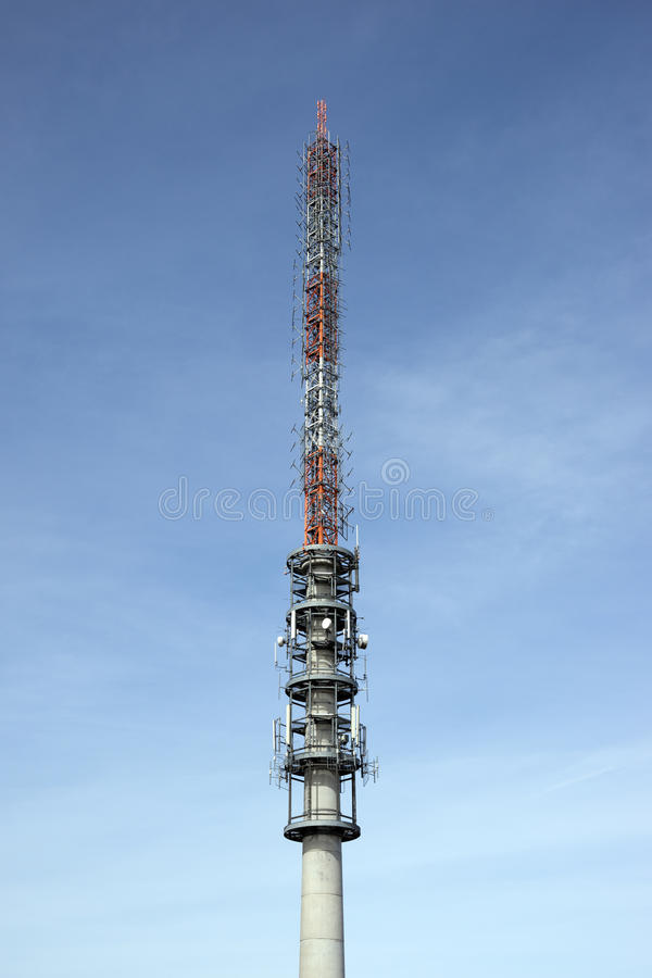 Telecommunication antenna tower. With the blue sky stock image