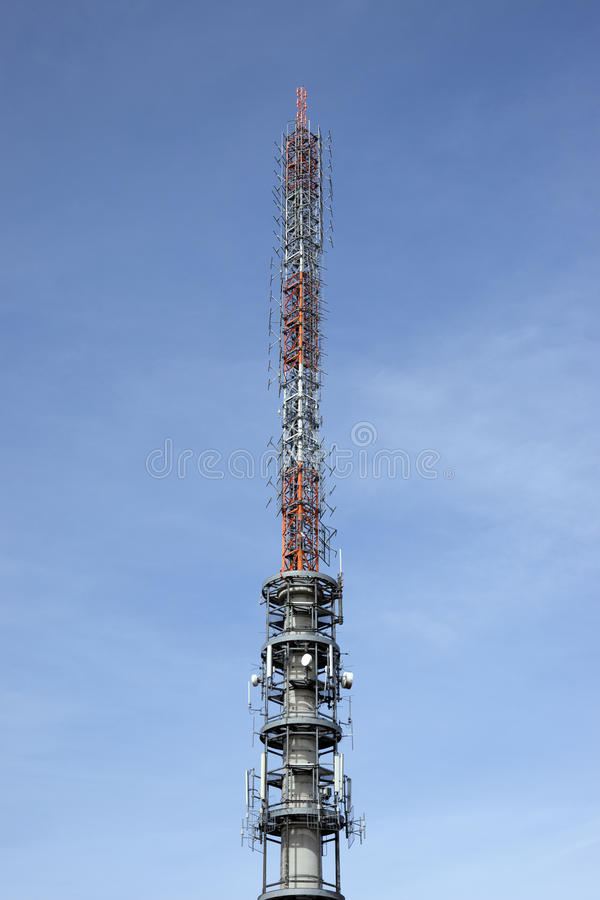 Telecommunication antenna tower. With the blue sky royalty free stock photography