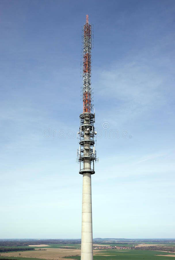Telecommunication antenna tower. With the blue sky royalty free stock image