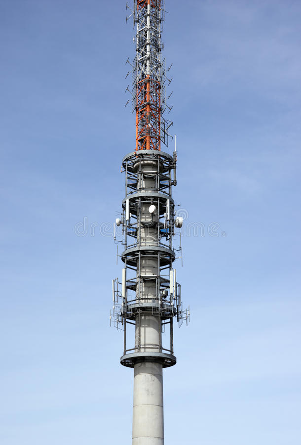 Telecommunication antenna tower. With the blue sky royalty free stock photo