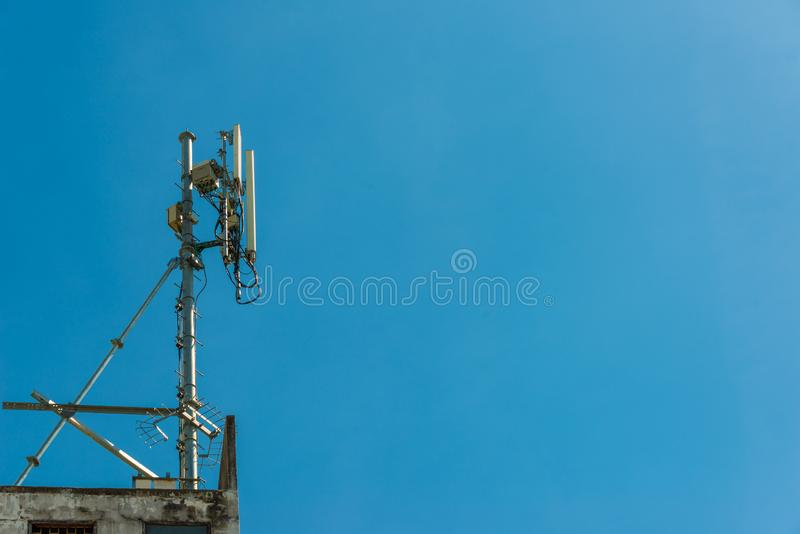 Antenna tower for telecommunication technology. Telecommunication antenna tower with blue sky background stock images