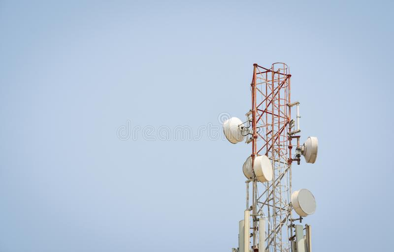 Telecommunication antenna tower with copy space. stock images