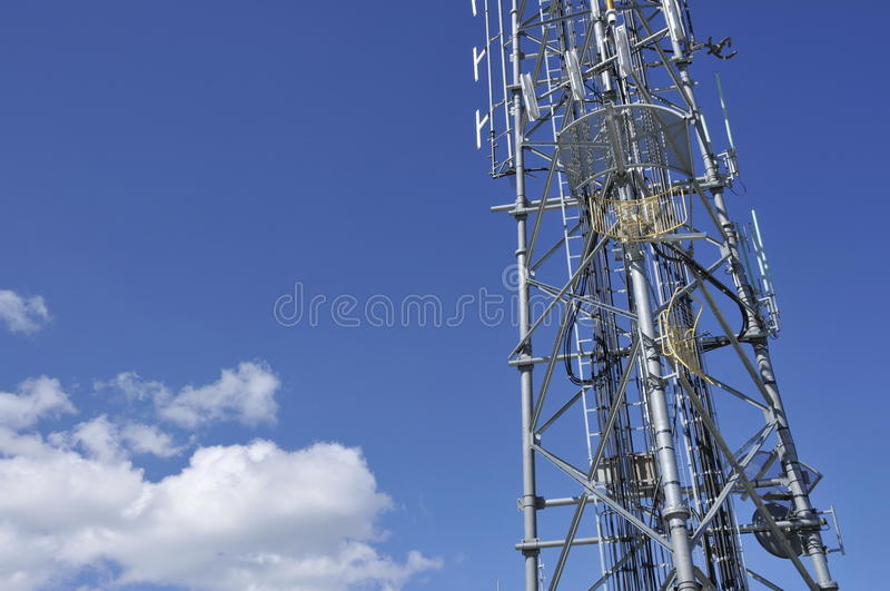 Telecommunication Antennas 2. Wireless Cellular Telecommunication Antennas on Top of Lattice Tower with Clouds in Background royalty free stock photo