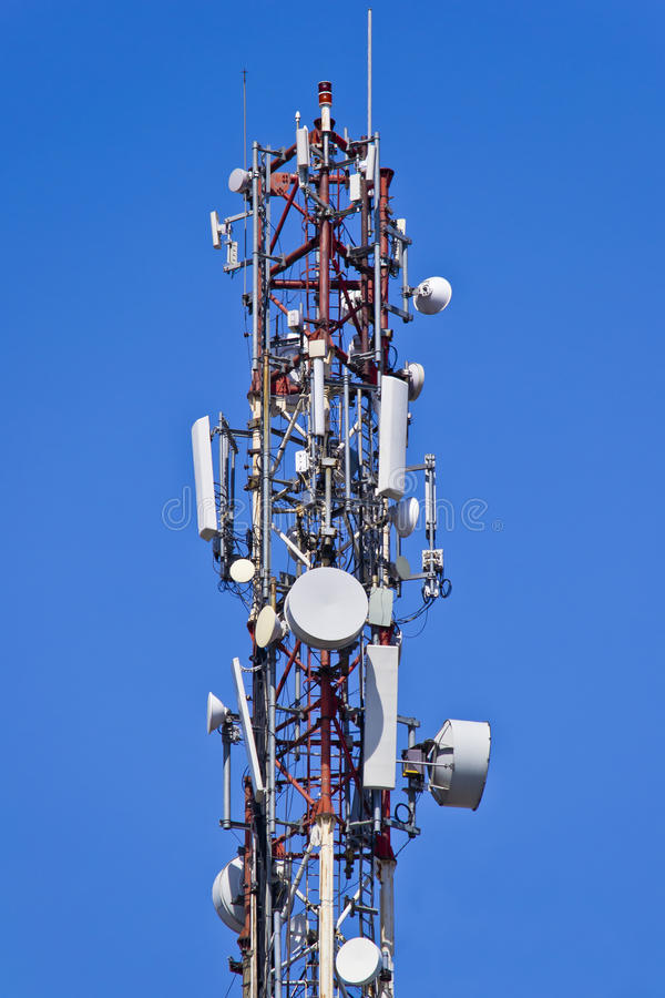 Telecommunication Antennas. Installation Of Antennas For Sending And Receiving Radio Signals On A Blue Sky stock images