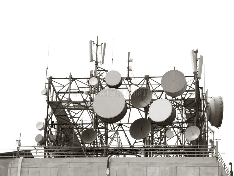 Telecommunication Antennas. A cluster of antennas on top of a telecommunication-agency building stock images