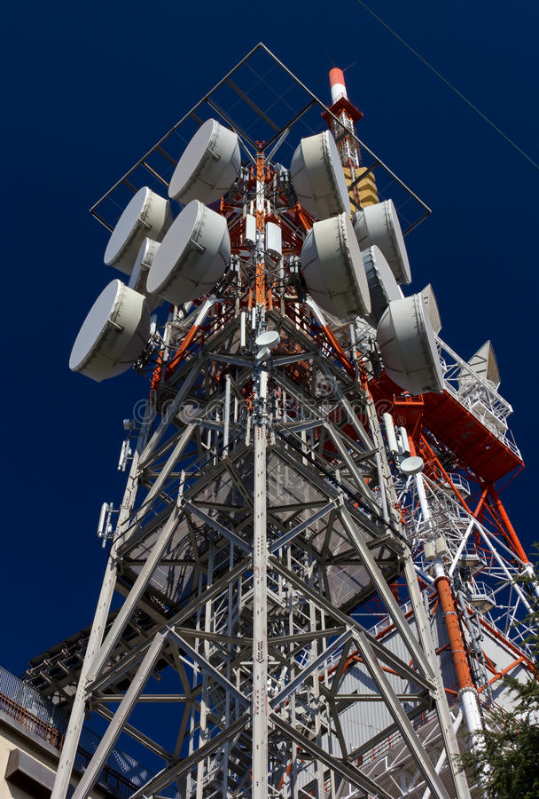 Telecommunication Antennas. Against a blue sky royalty free stock photography