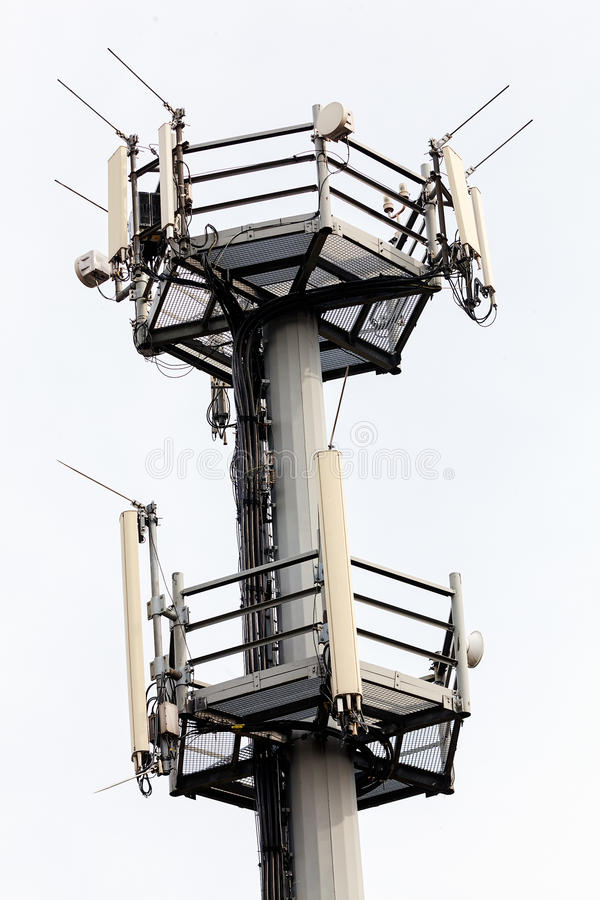 Telecommunication antennas. Telecommunication equipment on top of antenna tower royalty free stock images