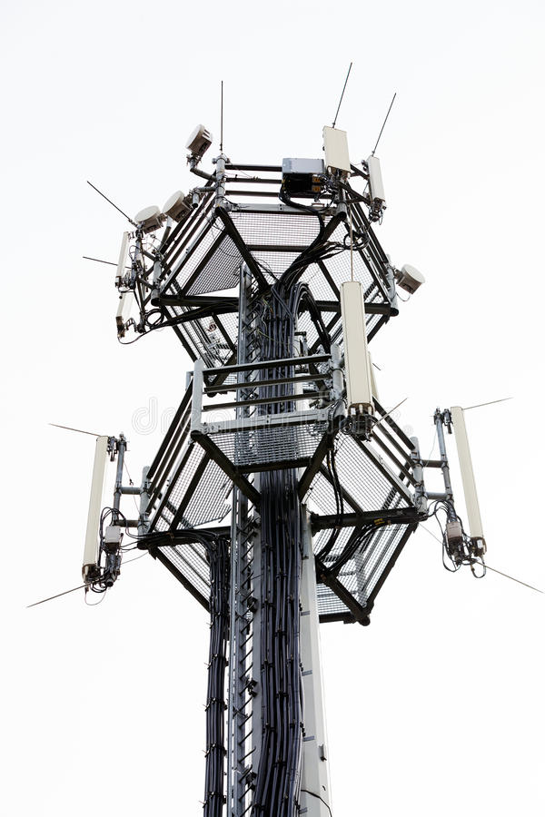 Telecommunication antennas. Telecommunication equipment on top of antenna tower stock images