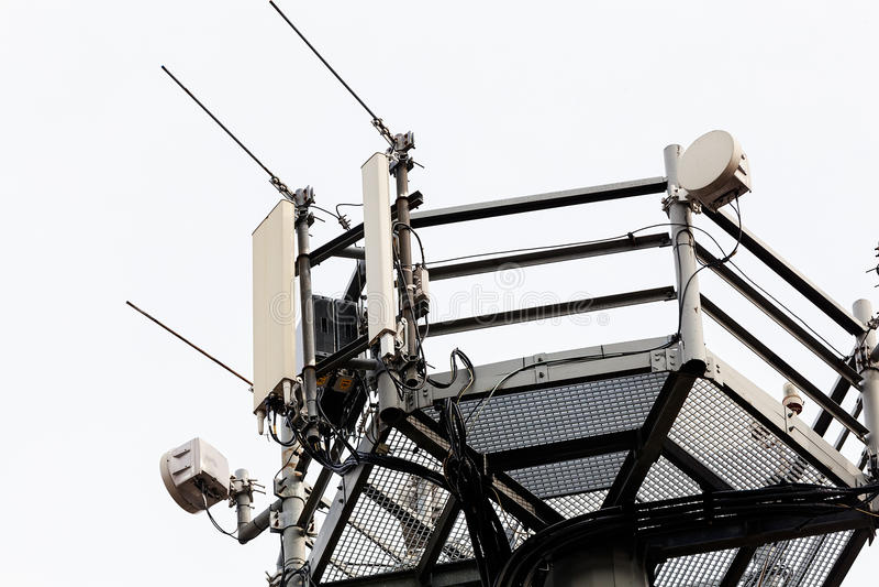 Telecommunication antennas. Telecommunication equipment on top of antenna tower royalty free stock image