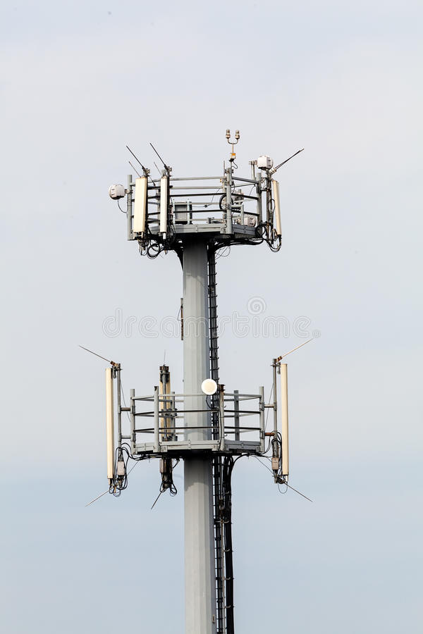 Telecommunication antennas. Telecommunication equipment on top of antenna tower royalty free stock photo