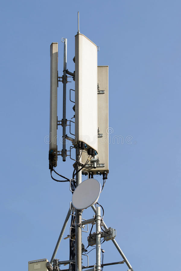 Telecommunication antennas for mobile operator. With blue sky without clouds and environment royalty free stock image