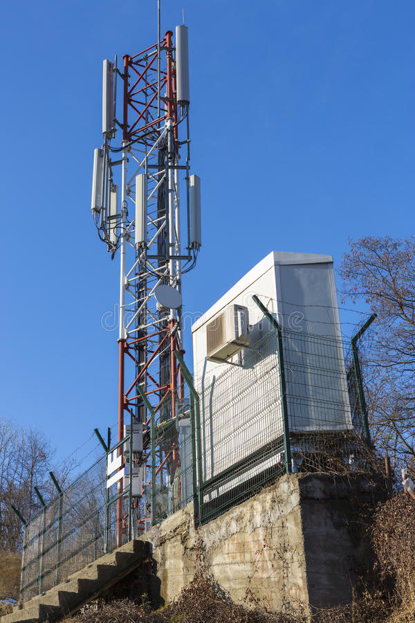 Telecommunication anthenna. Telecommunication tower with antennas on blue sky stock images