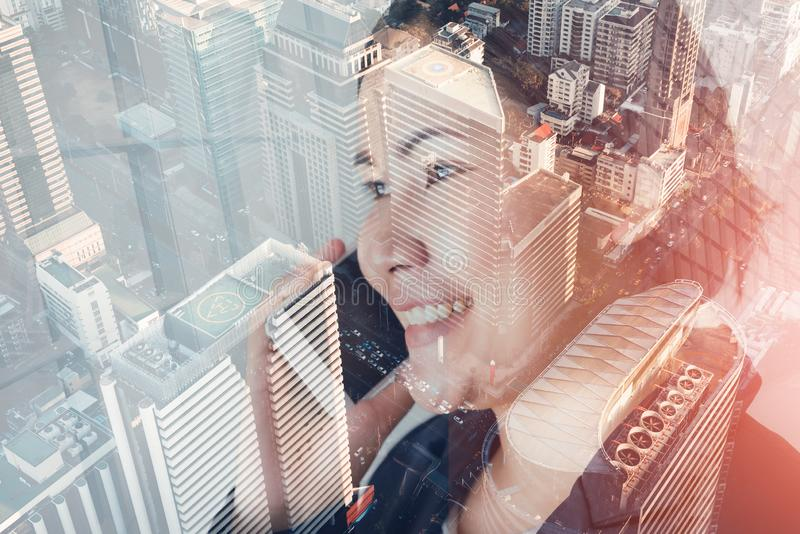 Telecommunication and Communication 5G Network Concept, Double Exposure of Business Woman is Using Smart Phone for Calling. Communicated and City Urban royalty free stock image