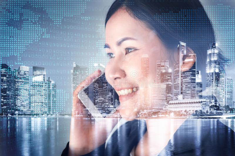 Telecommunication and Communication 5G Network Concept, Double Exposure of Business Woman is Using Smart Phone for Calling. Communicated and City Urban royalty free stock photos