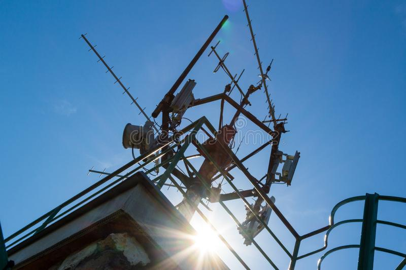 Telecommunication mast with antennas. On top of lookout tower royalty free stock photography