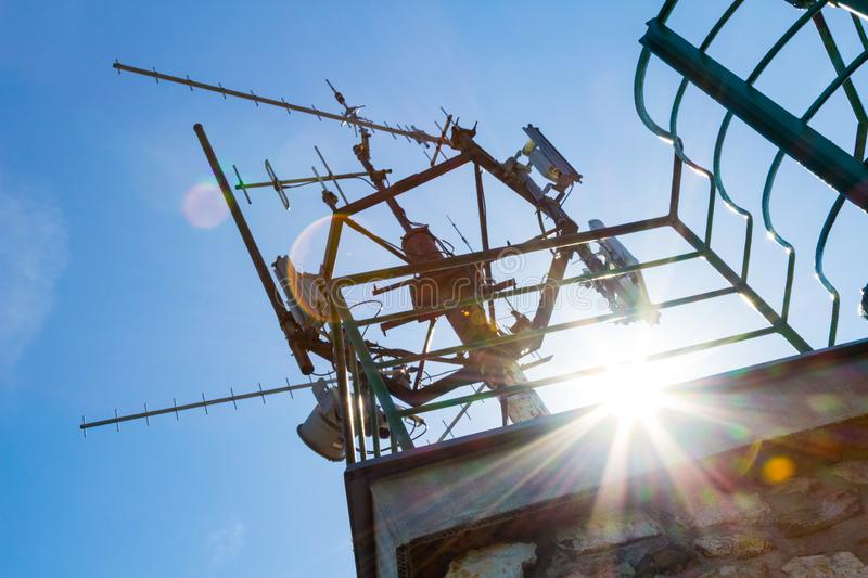 Telecommunication mast with antennas. On top of lookout tower observation point stock photo