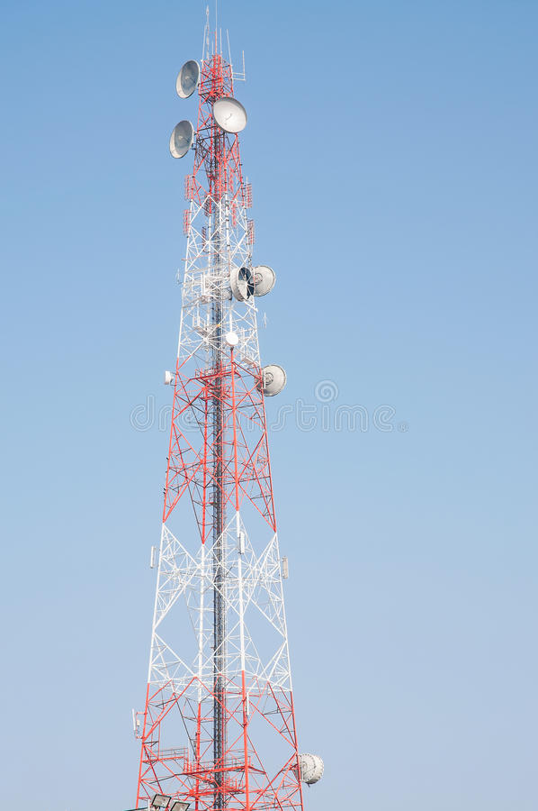 Telecommunication mast. With microwave link antennas over a blue sky royalty free stock photography