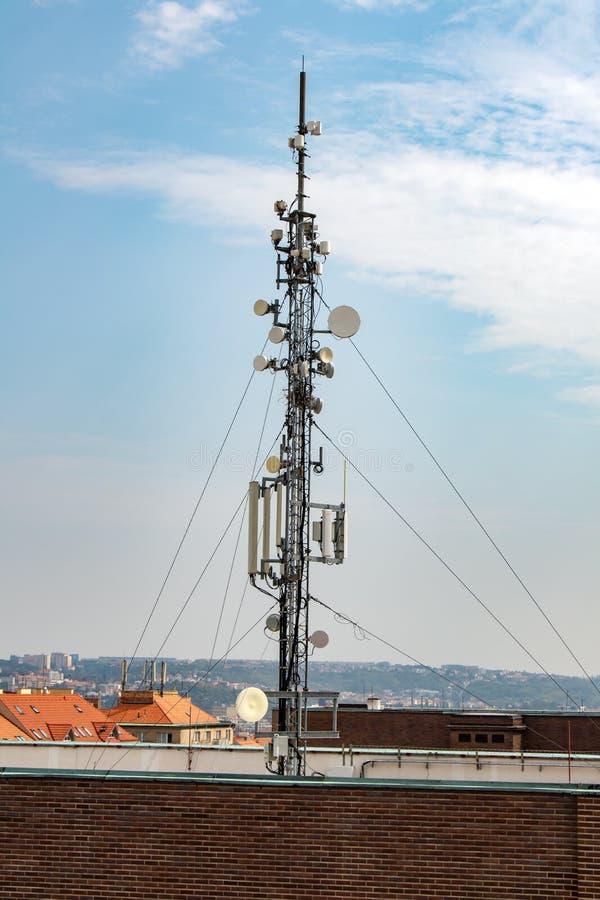 Telecommunication Room Design: Telecommunication Mast On Top Roof At Sunset Stock Photo