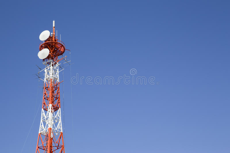 Telecommunication mast TV antennas. With blue sky stock photos