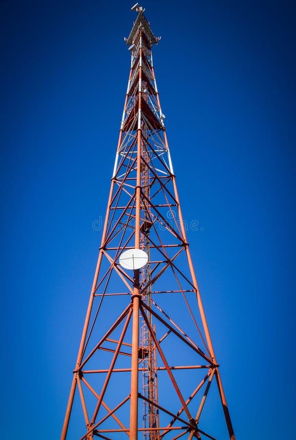 Telecommunication mast TV. Antennas on blue sky background royalty free stock images