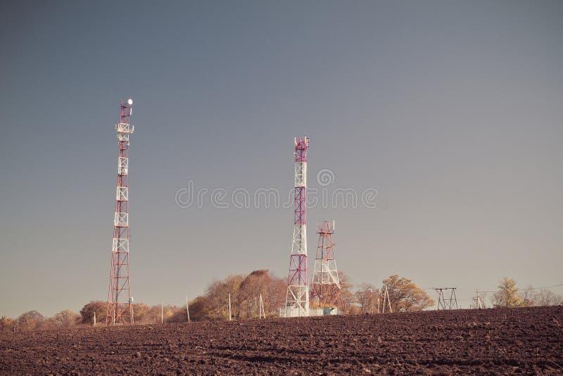 Telecommunication mast TV. Antennas on blue sky background royalty free stock photo