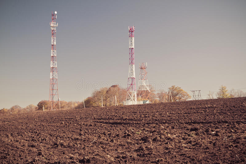 Telecommunication mast TV. Antennas on blue sky background stock image